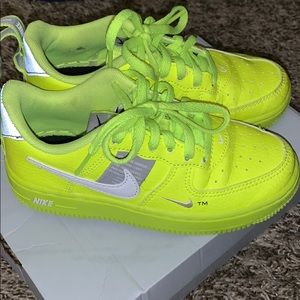 Neon green Nike forces